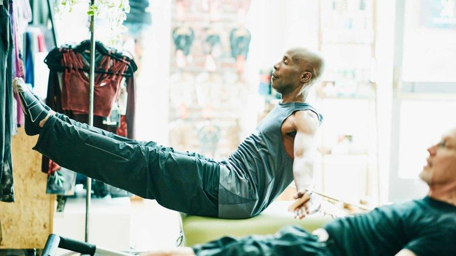 Men doing Pilates on reformers